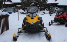 picture of snowmobile parked on snow waiting to run