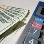 Sales Tax Accounting. Money and a calculator, online small business accounting for the self-employed